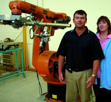 Karl Du Preez and Charmaine van Huyssteen with one of the Kuka robots in the Robotics Laboratory at NMMU